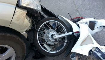 motorcycle crashed into front end of passenger car