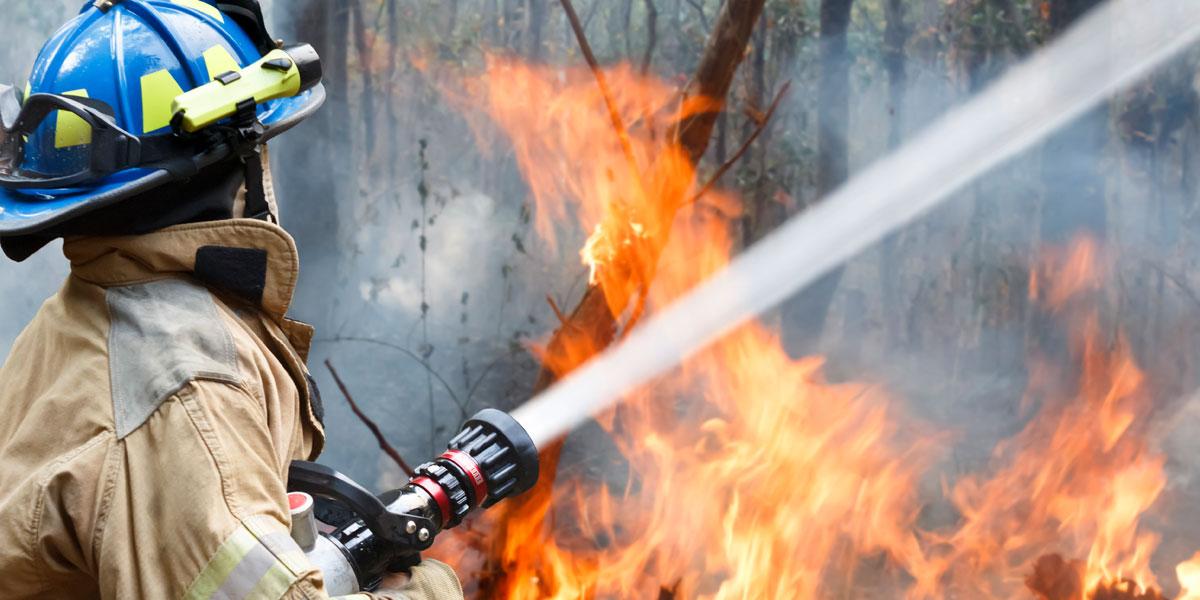 firefighter battles wildfire in Nevada